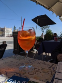 Enjoying Aperol Spritz at a Praça do Comércio cafe